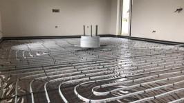 Podlahové vytápění - instalace na odrazovou fólii